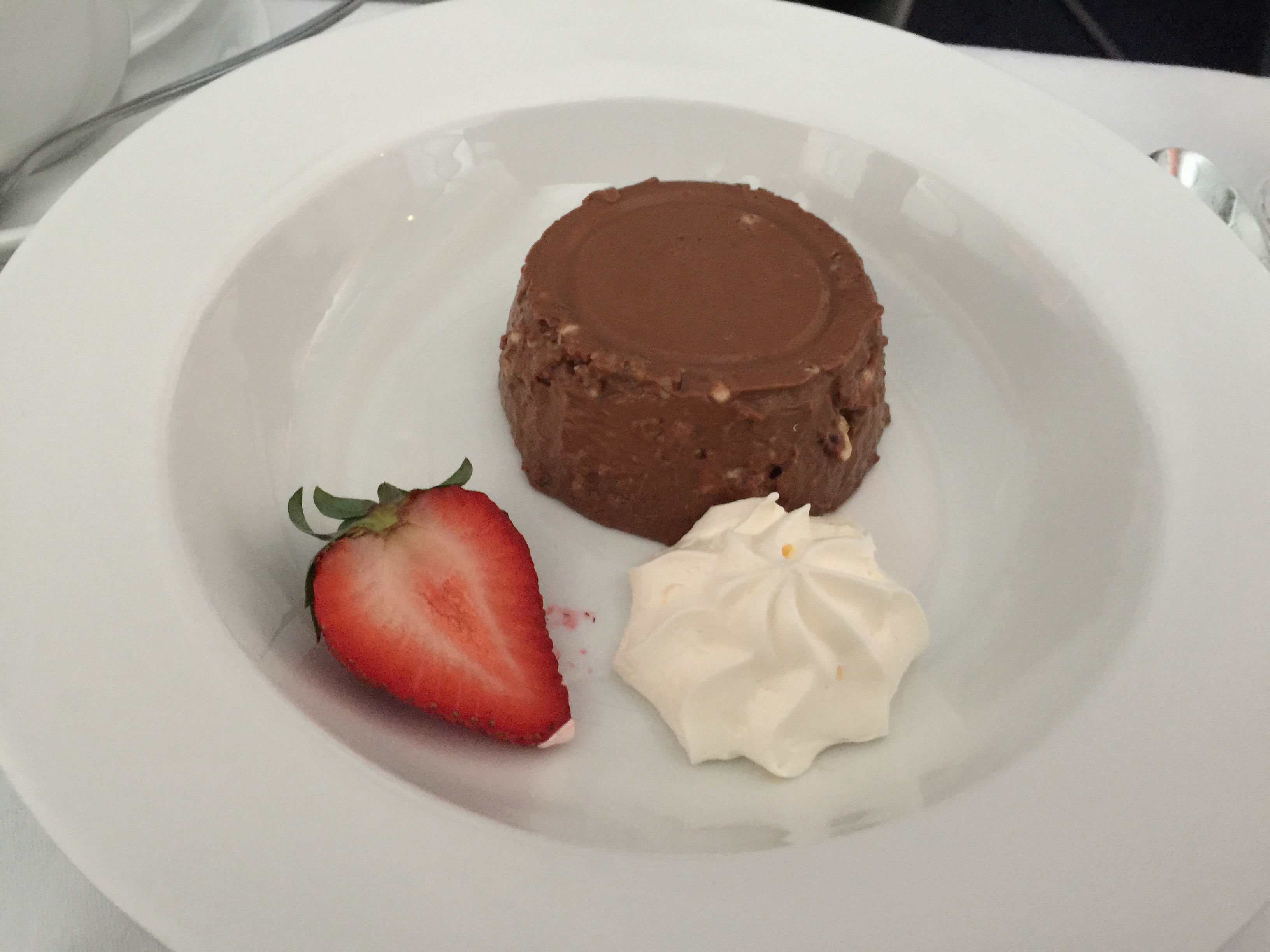 Dessert: Chocolate and Hazelnut pudding, served with whipped cream and fresh strawberry